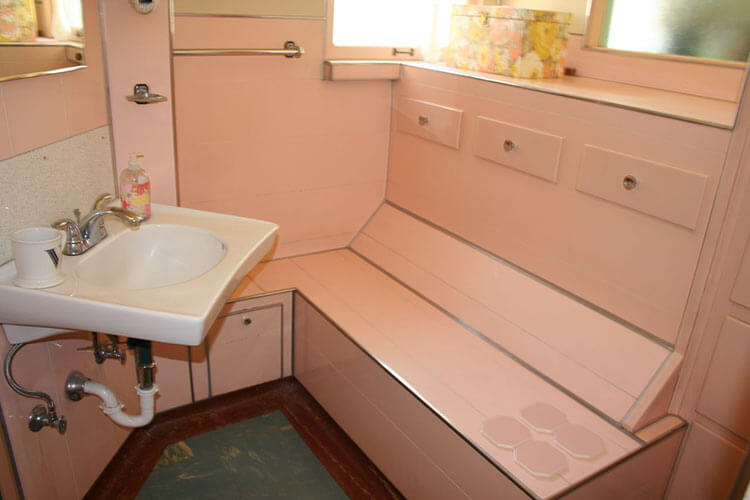 Noelle\'s 1930s bathroom with pink panel walls - Retro Renovation