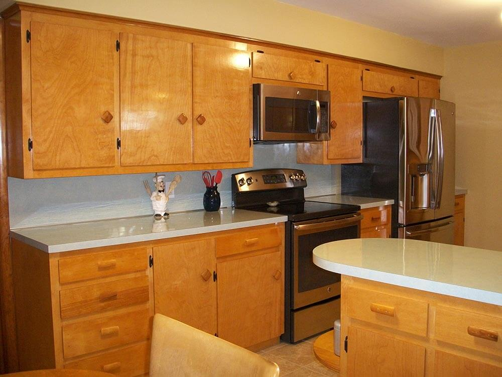 A family rebuilds and restores a 1953 kitchen to its for Mid range kitchen cabinets