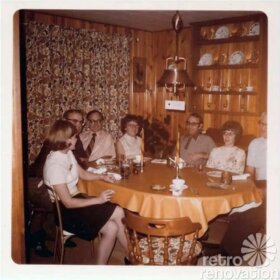 family in knotty pine kitchen