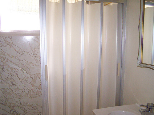 Folding accordion tub and shower doors - Retro Renovation