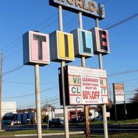world of tile sign
