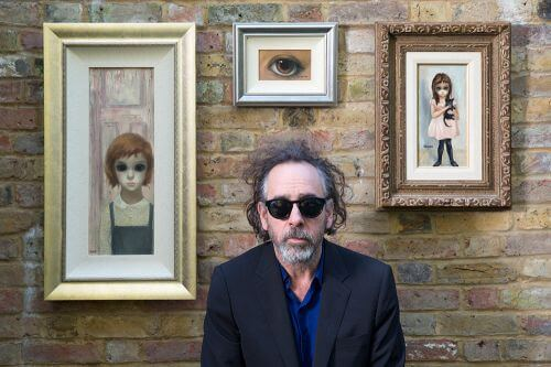 Tim Burton with his vintage Margaret Keane paintings, October 28, 2014. © 2014 The Weinstein Company. All rights reserved.