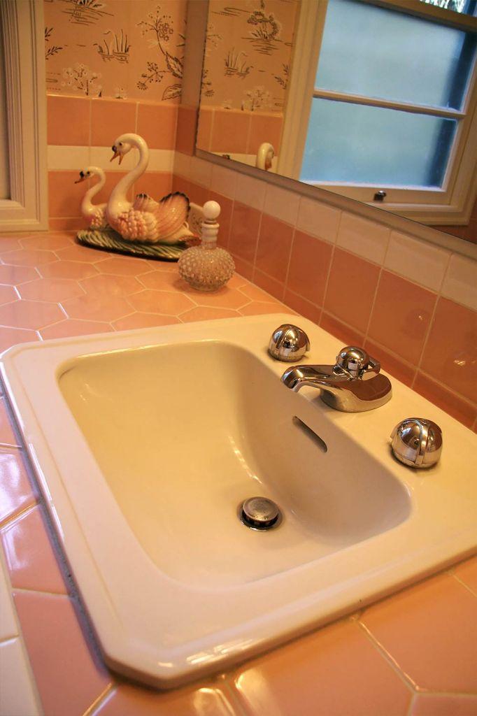 bathroom sink set into tile