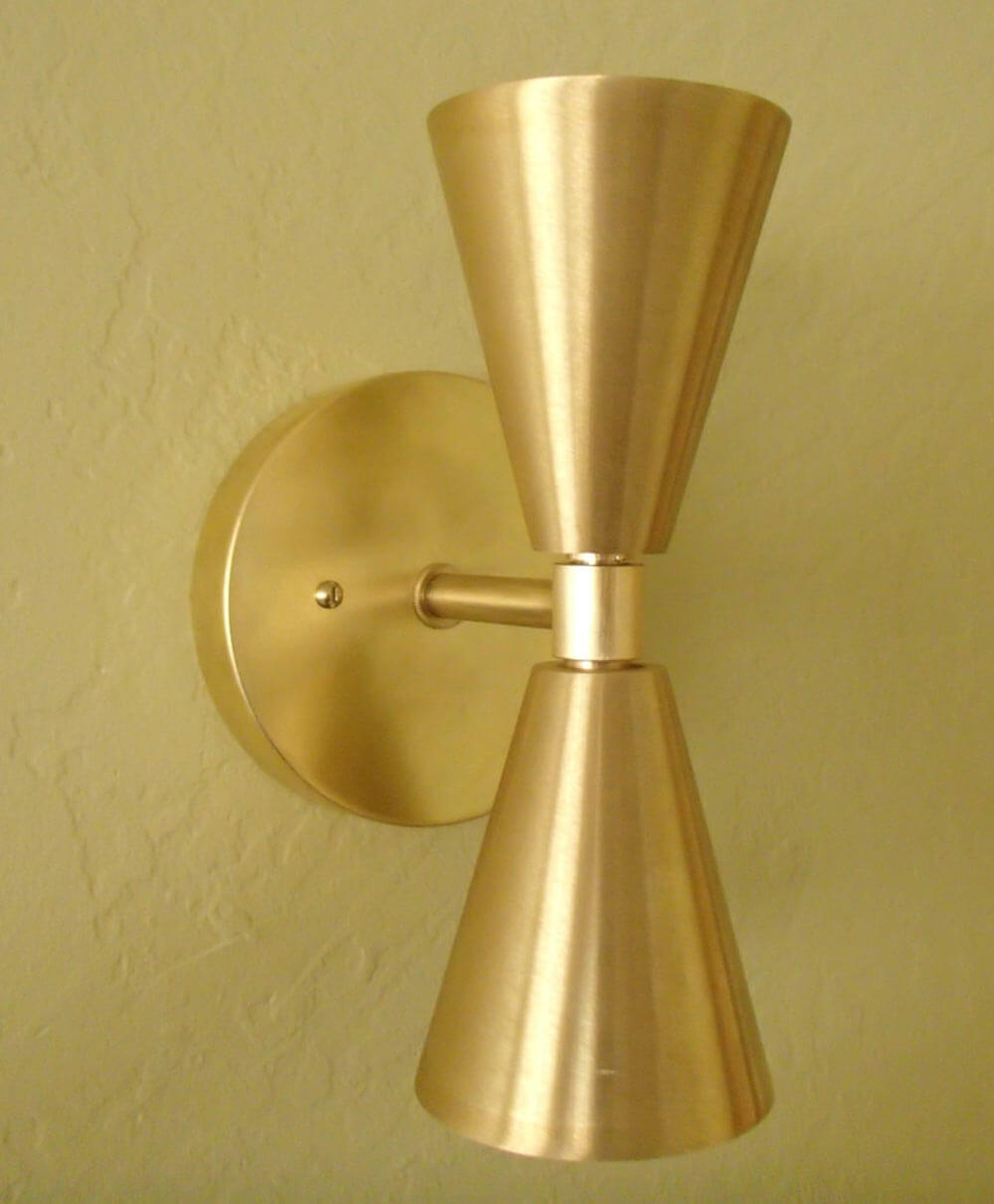 Six places to buy beautiful double cone bowtie lights from 79 brass midcentury wall sconce amipublicfo Image collections