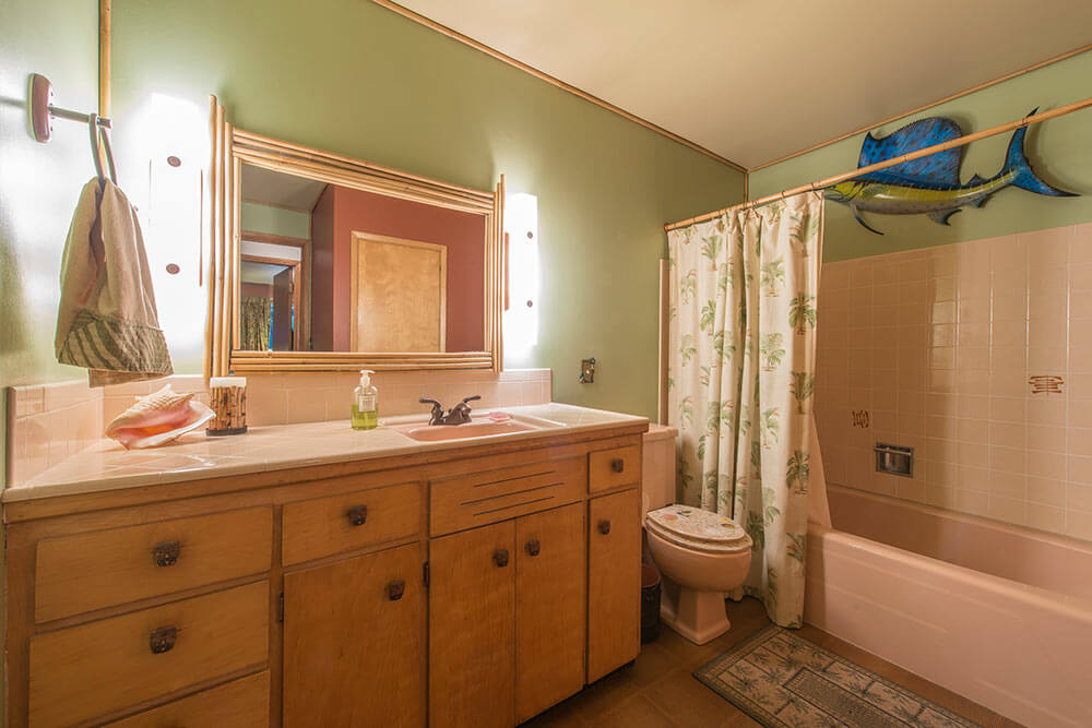 pink tile countertop and tub surround