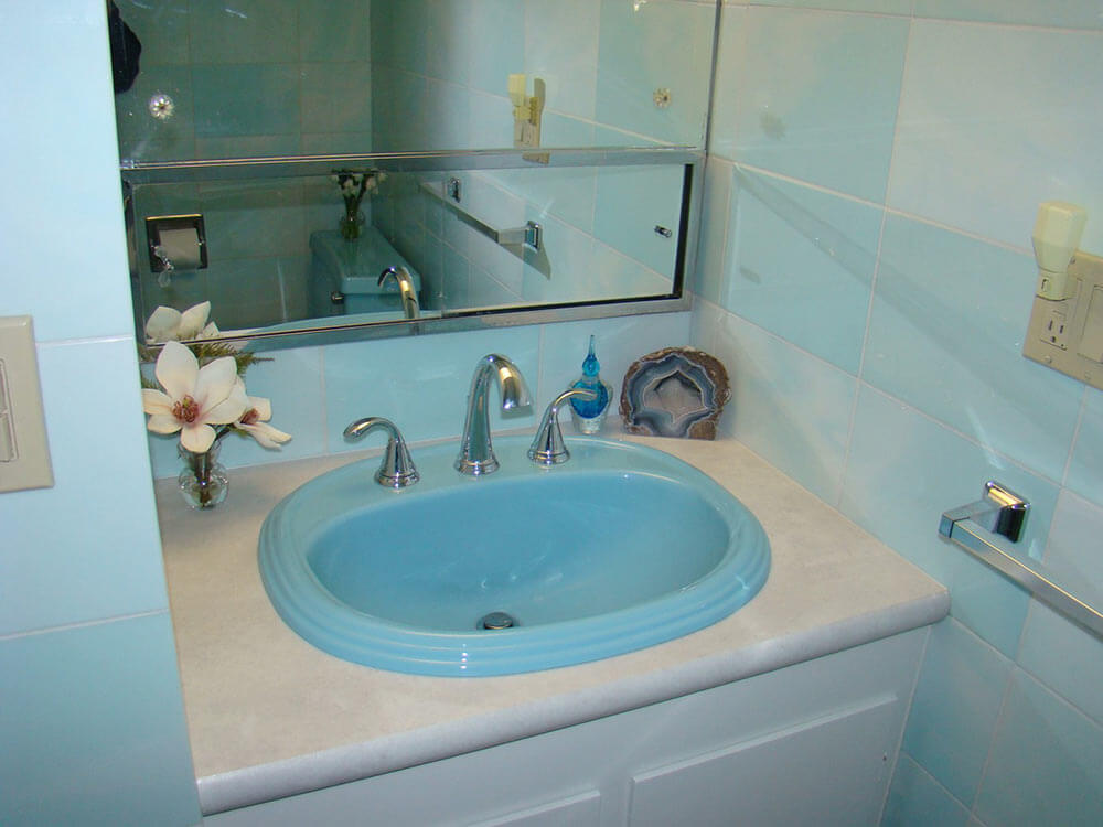 Paul paints 3 fiberglass bathroom sinks different colors at an auto ...
