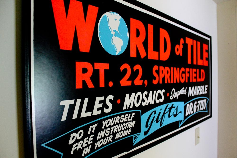 world of tile sign