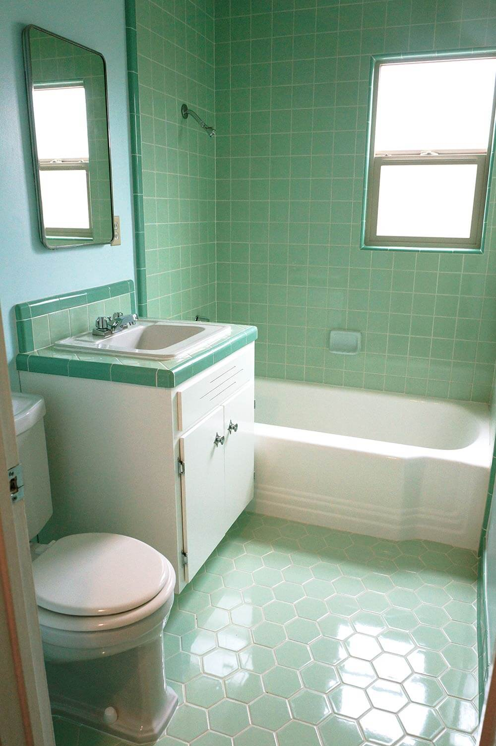 The color green in kitchen and bathroom sinks tubs and for 2 bathroom