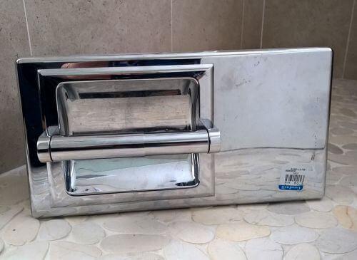 vintage conceal-a-roll toilet paper holder