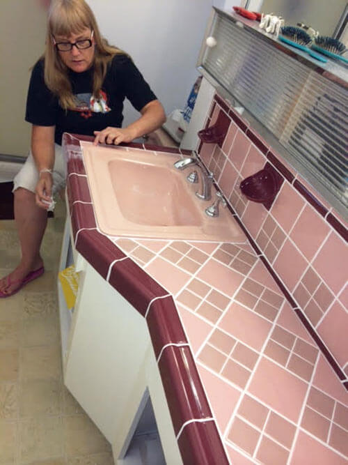 pink and maroon midcentury bathroom