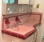 Reversing a bland big box remuddle, Dana builds a vintage pink bathroom