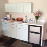 Vintage GE kitchen cabinets installed with a modern twist — I love it!