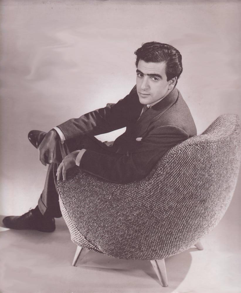 VLADIMIR KAGAN IN HIS SIGNATURE 100A BARREL CHAIR 1950S
