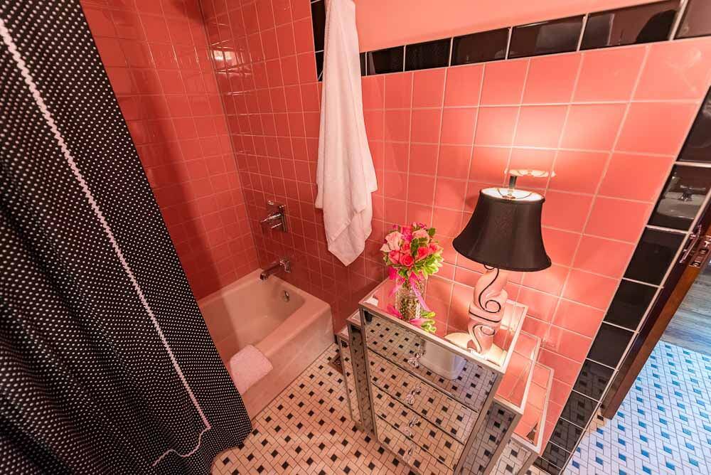 gorgeous pink mid century bathroom built new
