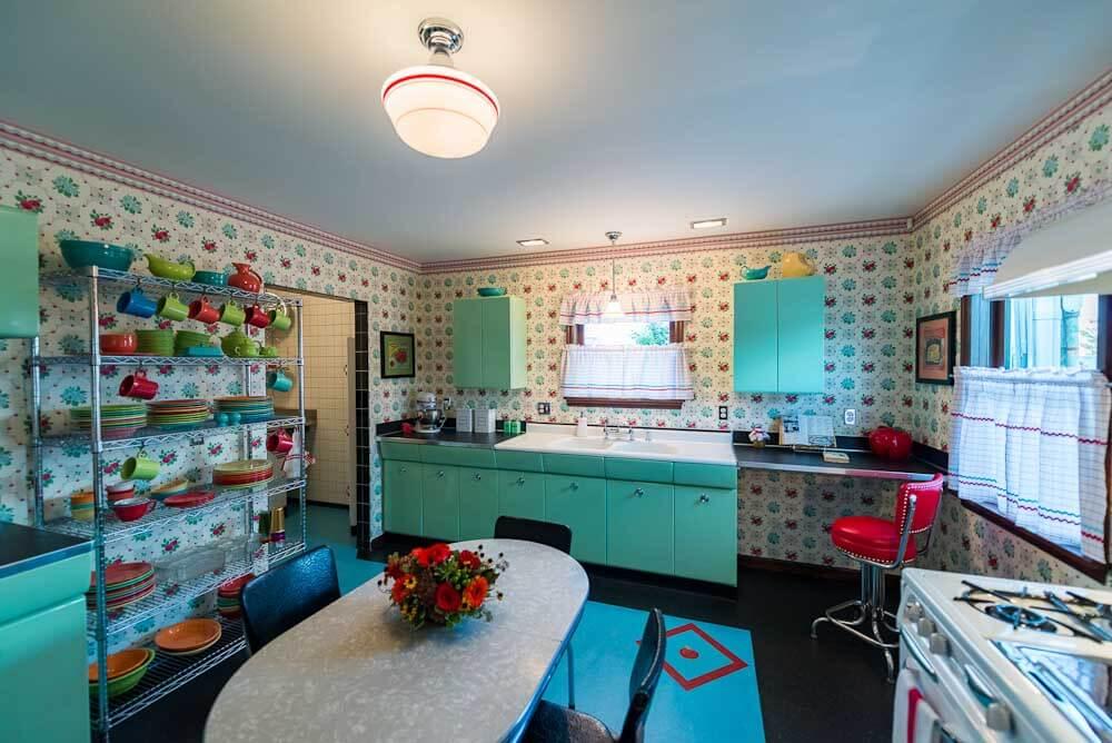 cheerful retro kitchen with bradbury wallpaper and aqua cabinets