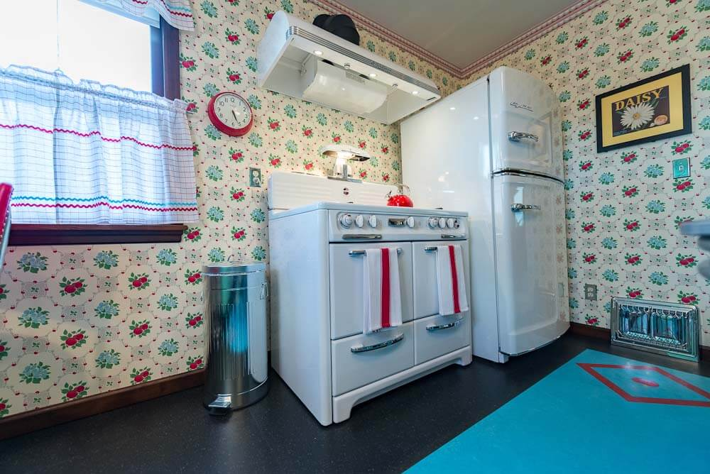 vintage westwood stove and big chill refrigerator in remodeled kitchen