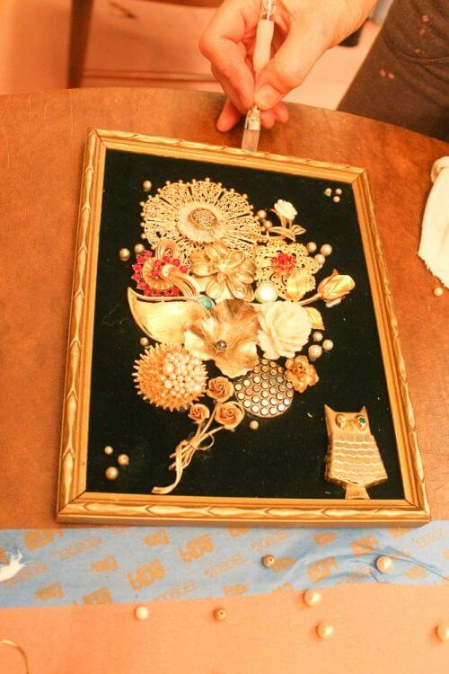 frame for art made from costume jewelry
