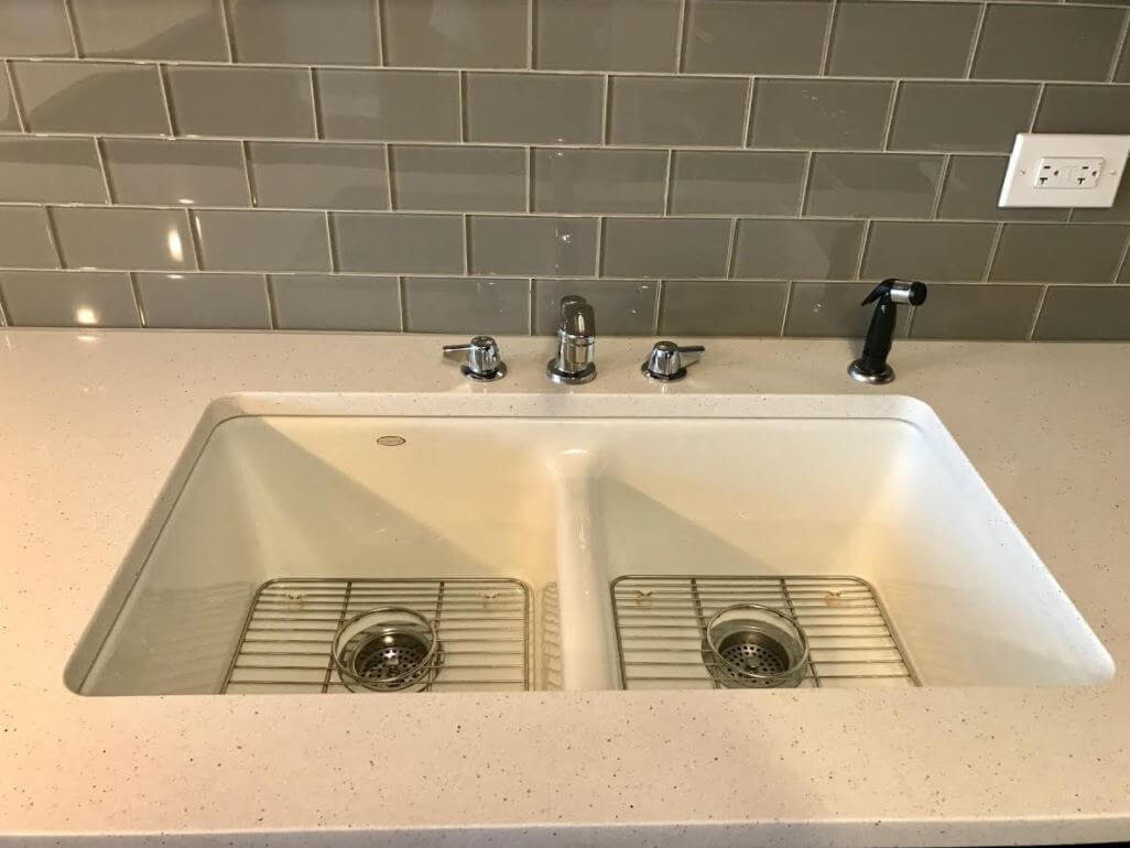 Cute I selected a KOHLER Cast Iron undermount sink and a Silestone ucMont Blanc ud countertop that kept with the spirit of the original gold flecks