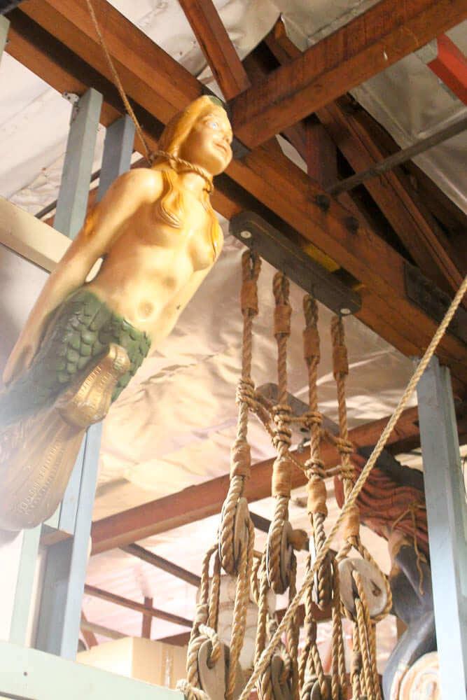 carved wood mermaid