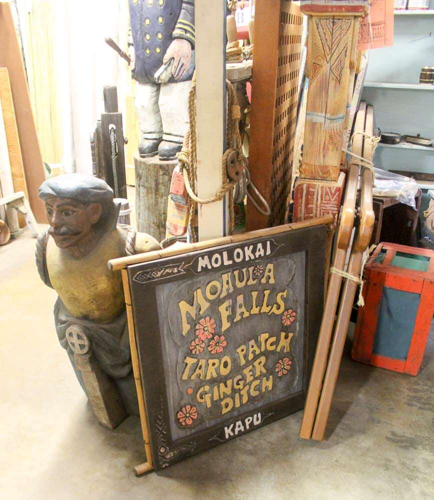 carved sign by LeRoy Schmaltz