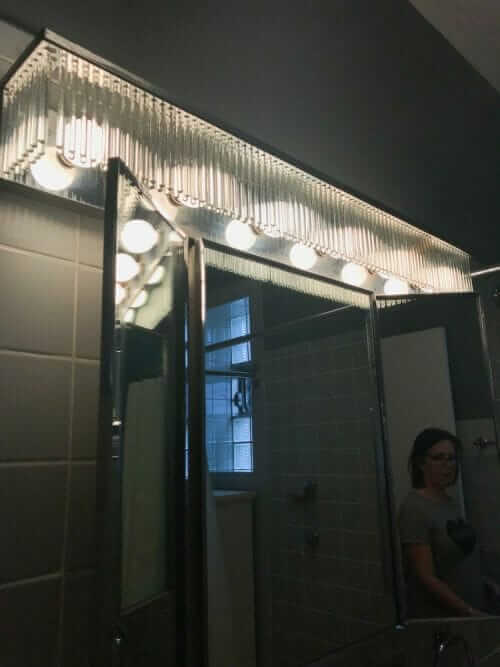 vintage bathroom light with prisms
