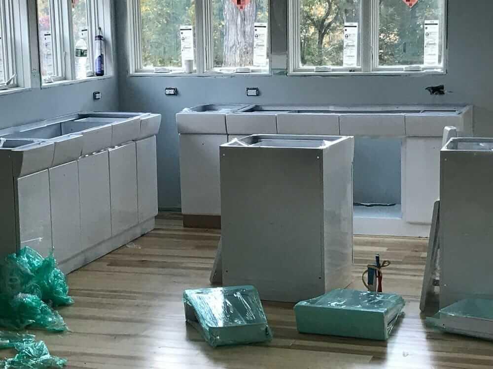 steel kitchen cabinets being installed