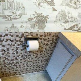 novelty wallpaper in a mid century bathroom