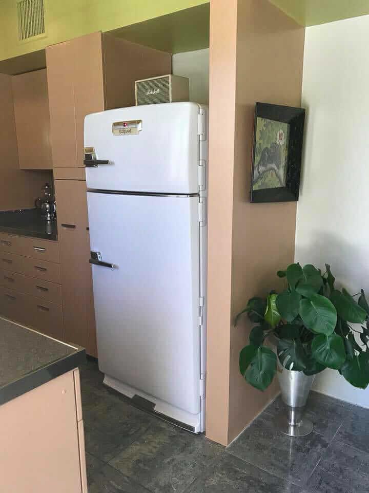vintage refrigerator in midcentury modern kitchen