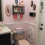 Lynn's pink poodle bathroom — including genius use of wallpaper fragments