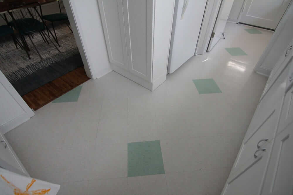 green and white tile kitchen floor