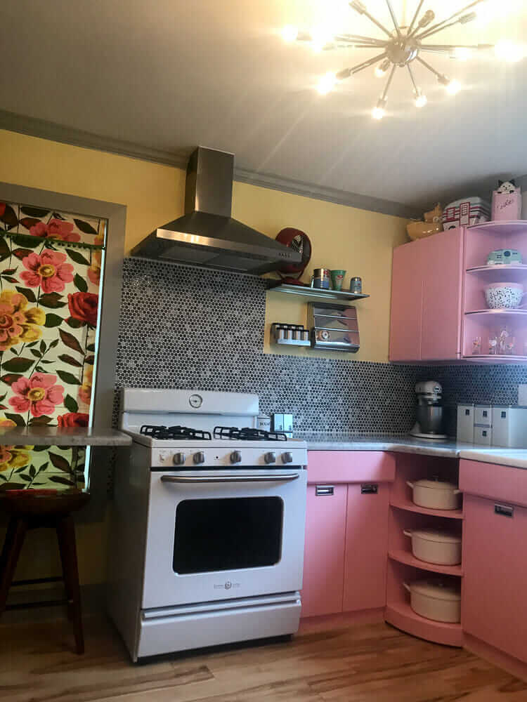 pink kitchen with retro stove