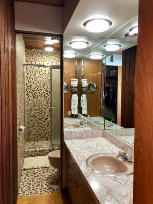 beige mosaic tile bathroom
