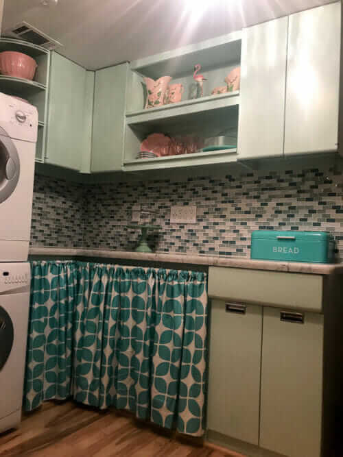 retro laundry room with sears steel kitchen cabinets