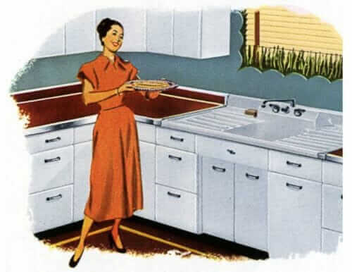 Woman working at a single sink with drainboards in her 1940s kitchen