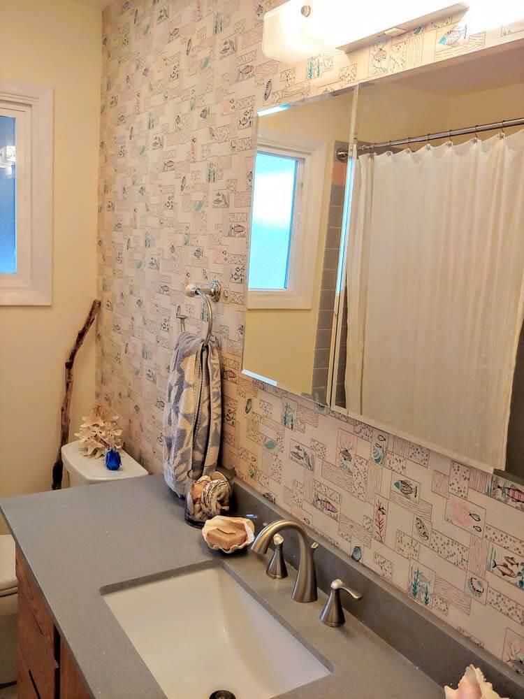 vintage wallpaper on one wall of bathroom