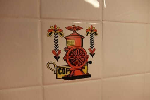 vintage trivet used as wall tile