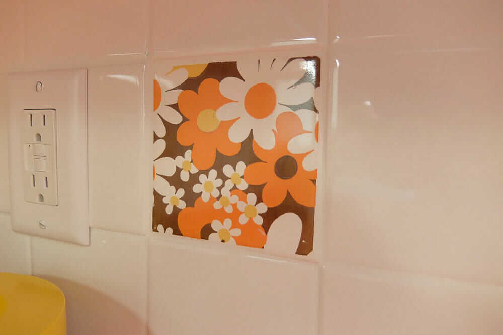 vintage trivets used as wall tile