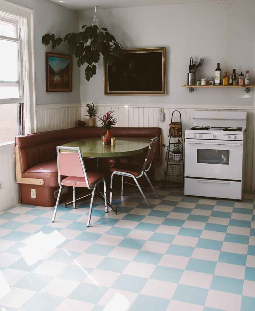 Blue and white checker floor in a retro or farmhouse style kitchen.