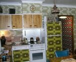 kitchen filled with vintage wallpaper
